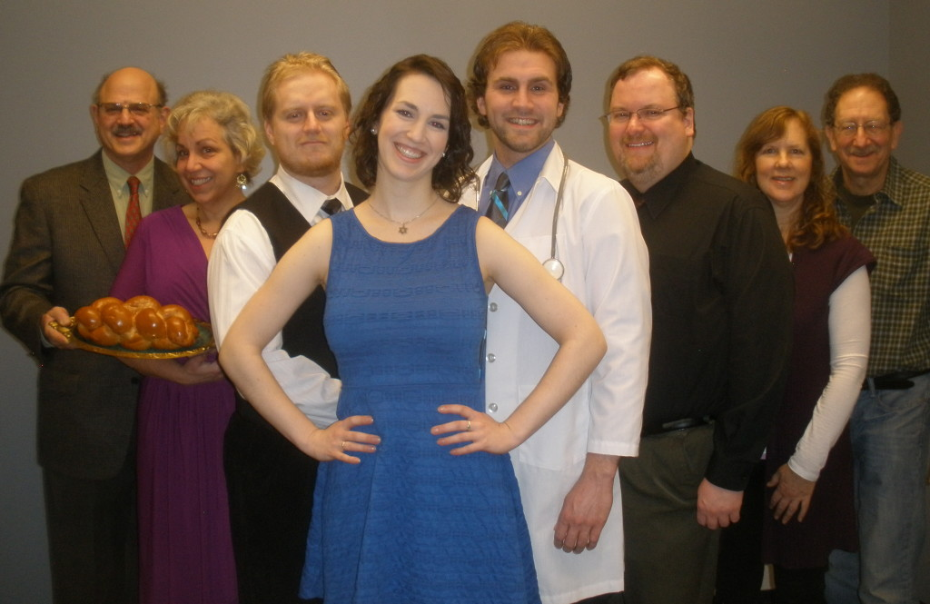 "It's all about Sara in the Seattle Jewish Theater Company's spring production of the romantic comedy hit, ""Beau Jest."" Left to right, Al Hilell, member of Temple Beth Am, Mary Brown, Isaiah J. Smith, Sara Schweid, MacKenzie Mott, Ian McIntire, Rona Feldman, assistant director, member of Congregation Beth Shalom, and Art Feinglass, director."